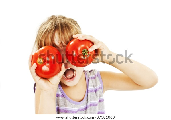Healthy lifestyle people. Funny image of little girl showing tomatoes.