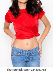 healthy lifestyle. sensual model with slim belly and soft skin. Sexy woman wearing red t shirt isolated on white background. Beauty girl shows slim body. dieting and fitness concept