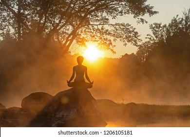 Healthy Lifestyle. Silhouette meditation yoga woman for relax vital and energy in the morning at the hot spring park. Healthy Concept