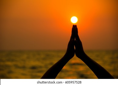 Healthy lifestyle. Silhouette meditation yoga woman amazing sunset.