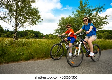 Healthy lifestyle - teenage girl and boy riding bikes