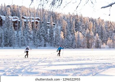 Healthy lifestyle. Winter sport skiing. Winter lake in Kuusamo Ruka. Finland. - Shutterstock ID 1296522955