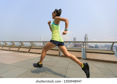 Healthy lifestyle woman runner running on foggy city morning