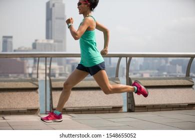 Healthy lifestyle woman runner running at Hong kong