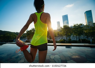 Healthy lifestyle woman runner warming up before running