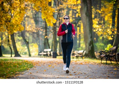 Healthy lifestyle - woman running in city park