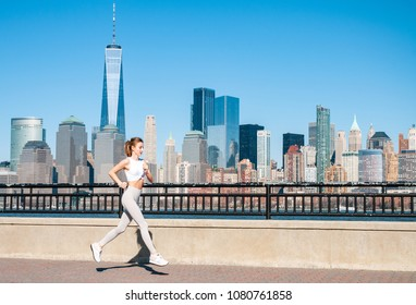 Healthy lifestyle. Woman is running in New York City. Fitness sports runner is jogging in Liberty State Park