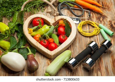 Healthy lifestyle for women diet with sport equipment, sneakers, measuring tape, vegetable fresh, green apples and bottle of water on blue wooden. Healthy Concept