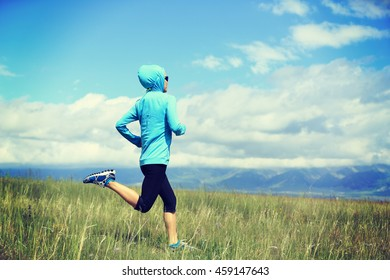 healthy lifestyle young fitness woman runner running on grassland