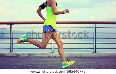 healthy lifestyle young fitness woman running at seaside