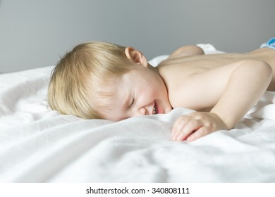 A Healthy Lifestyle of young little children boy on bed