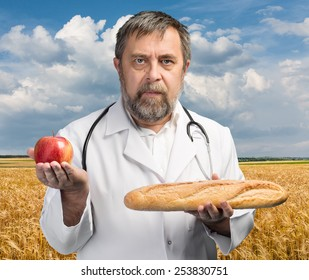 Healthy lifestyles concept. Doctor chooses apple for healthy eating and lifestyle or good diet on nature background
