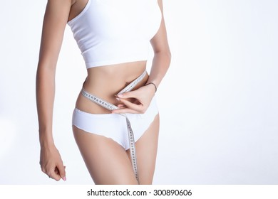 Healthy lifestyles concept. Woman measuring perfect shape of skinny hips.