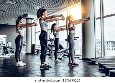 Healthy lifestyle.Sporty young women exercising at gym.