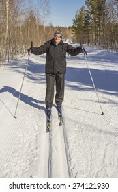 Healthy lifestyle.Woman in autumn winter forest skiing day.