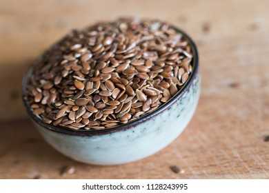 healthy linseed flaxseed grain cereal in bowl on wooden table