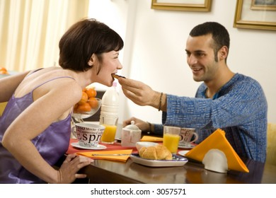 healthy living: young couple having breakfast at home