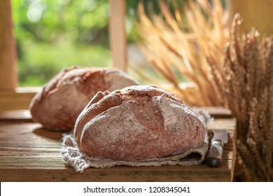 Healthy loaf of bread with grain and ears