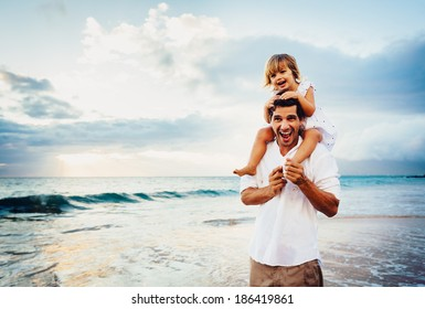 Healthy loving father and daughter playing together at the beach at sunset Happy fun smiling lifestyle