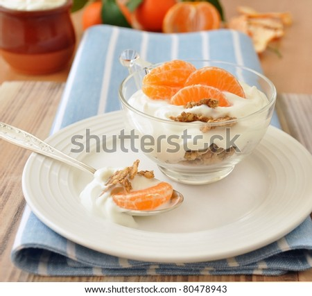 Healthy low calorie breakfast with natural yogurt, mandarin and corn flakes