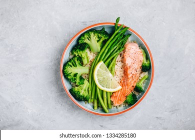 Healthy lunch bowl salmon and broccoli with asparagus and rice. Top view