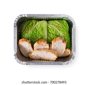 Healthy lunch in foil container. Healthy food take away and delivery. Chicken and lettuce in box on white background, closeup, isolated