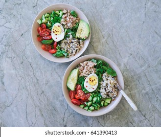 Healthy Lunch, Salad Bowl with Tuna, Arugula, Brown Rice, Tomatoes, Egg and Avocado. Top View, Toning.