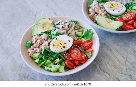 Healthy Lunch, Salad Bowl with Tuna, Arugula, Brown Rice, Tomatoes, Egg and Avocado. Toning. Selective Focus.