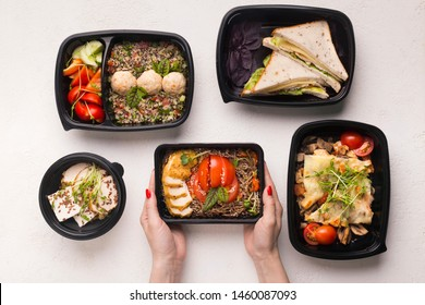 Healthy lunch. Tasty food in different boxes for day ration in woman hands