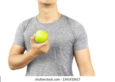 Healthy man holding fresh green apple isolated in clipping path.