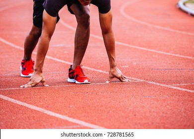 Healthy man running and jogging in morning ;Healthy people in run track of public stadium