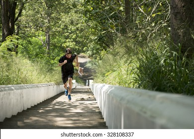 Healthy man running upstairs.Training for strength.