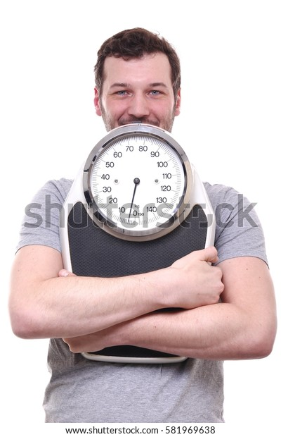Healthy man with a scale