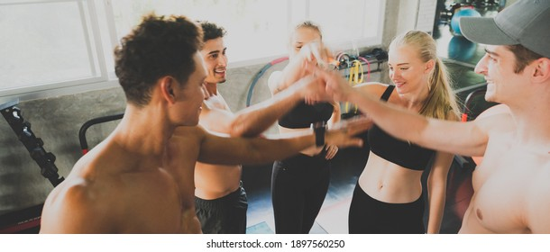 healthy man and woman person group exercise and training in sport fitness gym, lifestyle of healthy friends together