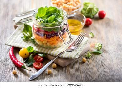 Healthy mason jar salad with chickpea and veggies, diet, vegetarian, vegan food