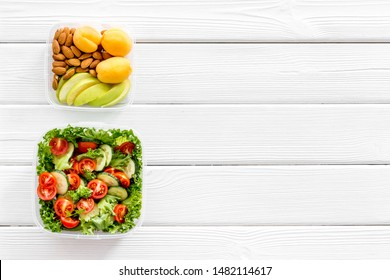 healthy meal in lunch box to take away on white wooden background top view mockup
