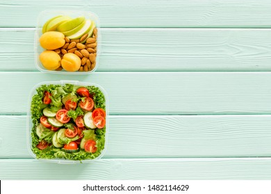 healthy meal in lunch box to take away on mint green wooden background top view mockup