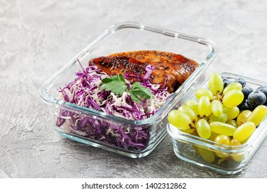 Healthy meal prep container with  chicken and cole slaw. Container with berries.