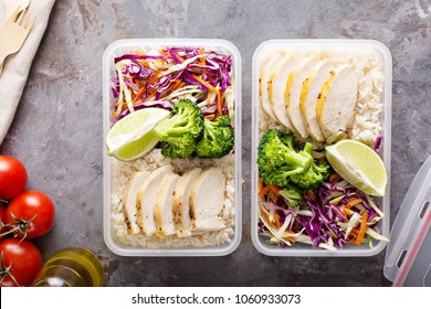Healthy meal prep containers with chicken, rice and cole slaw salad