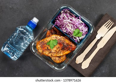 Healthy meal prep containers with  chicken and cole slaw. Top view