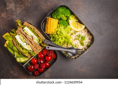 Healthy meal prep containers with feta sandwich with fruits, berries, rice and vegetables. Healthy vegetarian food concept. Takeaway food.