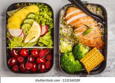 Healthy meal prep containers with grilled chicken with fruits, berries, rice and vegetables. Takeaway food on white background, top view