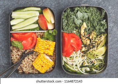Healthy meal prep containers with quinoa, avocado, corn, zucchini noodles and kale. Takeaway food. Dark background, top view.