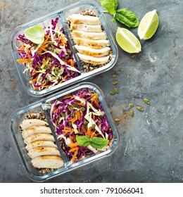 Healthy meal prep containers with quinoa, chicken and cole slaw overhead shot with copy space