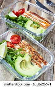 Healthy meal prep containers with rukola, turkey grill, tomatoes and avocado. Selective focus