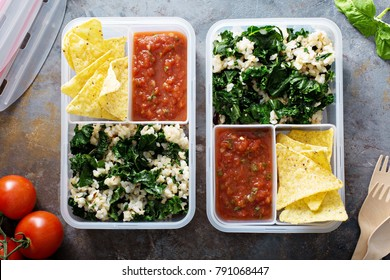Healthy meal prep or lunch for work and school, brown rice with kale, chips and salsa