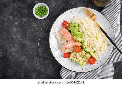 Healthy meal.  Salad with salmon, couscous, avocado and tomatoes. Top view, copy space, overhead. Eastern oriental lunch