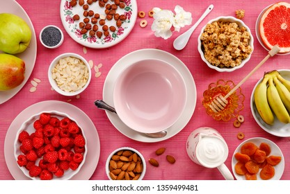Healthy meal. A set of products for preparing a healthy vegetarian and nutritious meal, granola, yogurt, fruits and nuts, top view. Healthy diet and eating concept