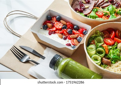 Healthy meal slimming diet plan daily ready menu background, organic fresh dishes and smoothie, fork knife on paper eco bag as food delivery courier service at home in office concept, close up view.