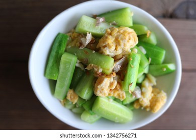 Healthy meal, stir fried vegetables or cucumber with chicken egg.Clean food